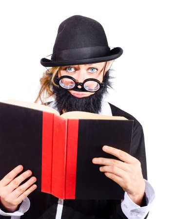 black rimmed: Woman in disguise wearing black bowler hat, fake beard and mustache with wide rimmed glasses reading science journal book Stock Photo