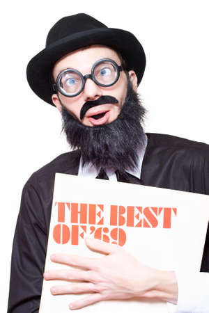 sixties: Funny Old Rock And Roll Man Holding Retro Vinyl Record In A Depiction Of Sixties Music Over White Background