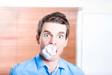 scrunched: Stressed office employee with scrunched up paper document in mouth. Work disaster