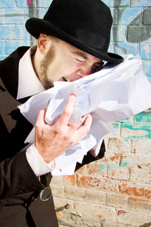 anguished: Upset Man Clutching At A Pile Of Scruntch Up Papers Crying Over Paperwork Blues