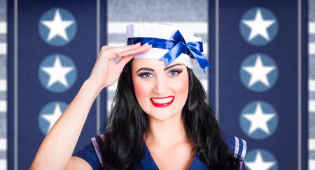 honour: Face of a classic 40s pin up navy girl saluting with adorable smile on military blue colours background