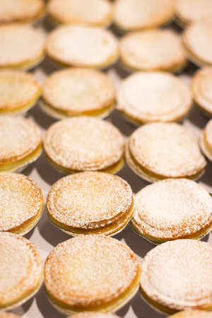 powdery: A Cooking Tray Full Of Pastry Mince Pies Fresh From An Oven Stock Photo