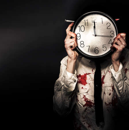 concealing: Battered And Blood Stained Business Man Hiding Behind A Clock Face In Countdown Concept Of A Time Deadline