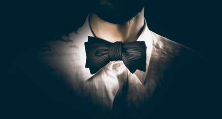 dress code: Close-up shot of a model man wearing classy bow tie, getting ready for a party, dinner or wedding Stock Photo