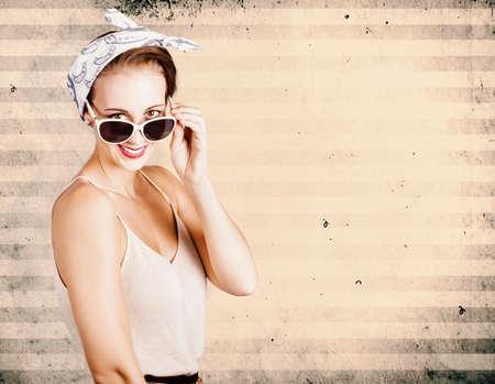 eyewear: Smiling grunge fashion model wearing handkerchief and fashionable eyewear on old distressed copyspace