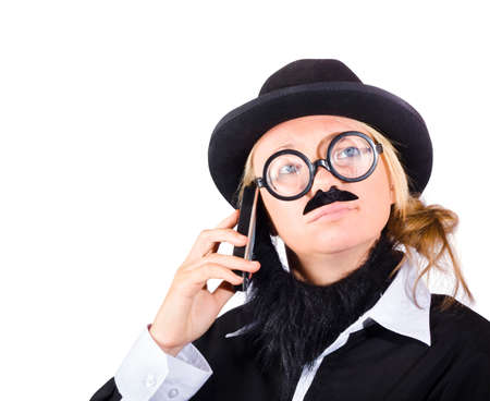 disguised: Young woman disguised as businessman with mobile telephone or smartphone, white background