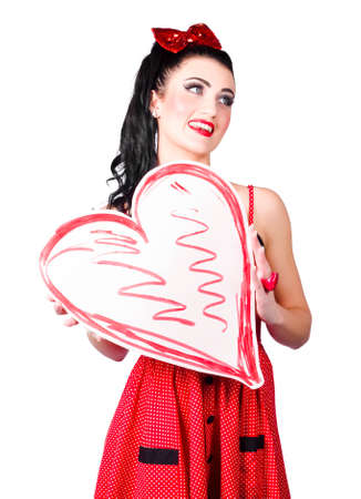 tryst: Cute Pinup woman from 1950 holding red heart love sign. In love with copy space