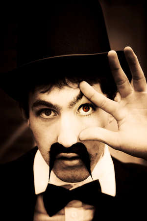 eye red: Evil Black And White Portrait Of Scary Retro Style Man With Top Hat, Handlebar Moustache And Red Eye Spying In A Retro Eye Spy Vision