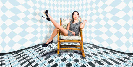 dress up: Abstract fashion portrait of a beautiful young woman sitting in a trendy high heel shoes Stock Photo