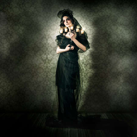 brunette woman: Dramatic Dark Portrait Of A Beautiful Gothic Model Posing Inside Vintage Haunted House In A Depiction Of Alternative Fashion