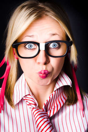 puckered lips: Funny face portrait of an intellectual businesswoman with shocked expression, thinking with pouted lips on dark background