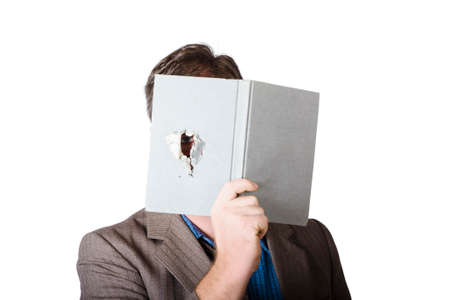 clandestine: Businessman peeking through spyhole in book when investing competition. Business spy