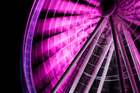 motion picture: A Purple Ferris Wheel Is The Star Of A Entertainment Motion Picture, Reduced To One Frame Stock Photo