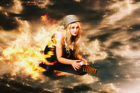 hostile: Digitally manipulated artwork of a pin up army girl launching into action on a military missile when making a pre-emptive strike during hostile war conditions. Kamakazi bomber