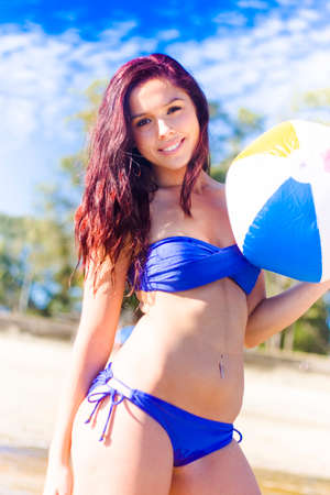 beachball: Happy Smiling Beautiful Beach Babe Playing With An Inflatable Beachball Or Beach Ball Outdoors In A Fit Active And Healthy Lifestyle Concept Stock Photo