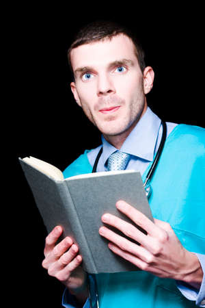 medical cure: Stern Male Medical Professional Holding Medical Research Book In A Depiction Of A Unsolved Cure