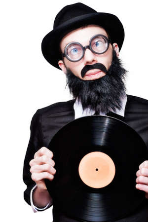 60's: Humorous Portrait Of A Sixties Retro Rock Man With Beard Moustache And Glasses Holding Music Record Vinyl In A Depiction Of 60s Rock N Roll Music
