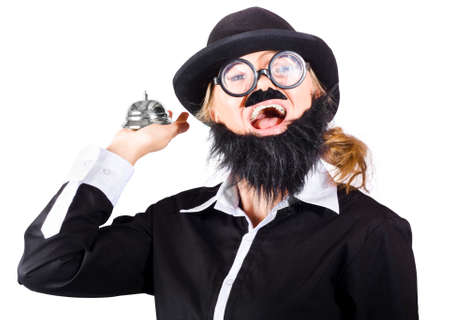 disguised: A woman in fake beard and mens clothes with a service calling bell. Good old fashion service Stock Photo