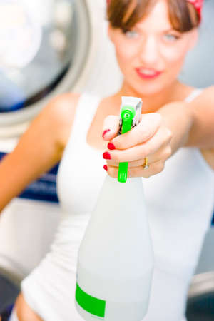 spray bottle: House Cleaning Holdup See A Woman Holding A Bottle Of Household Cleaner Liquid Taking Aim With The Spray Bottle In A Sharp Shooter Action Concept Stock Photo