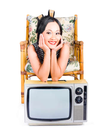 analogs: Retro image of a young beautiful chinese woman resting on top of an old retro tv, over white background Stock Photo