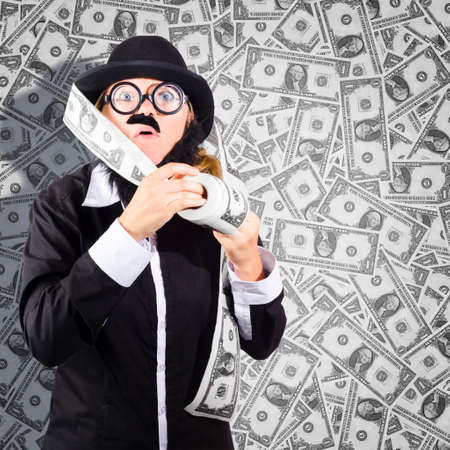 bogus: Quirky portrait of a fraudulent business person duplicating rolls and rolls of money when cheating the federal reserve bank. Counterfeit concept Stock Photo
