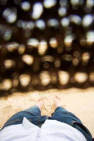 catnap: First Person Perspective Of A Man With A Straw Hat Covering His Eyes Lying Asleep At A Beachside Location