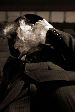 yesteryear: Clouded In A Smokey Haze A Man From Yesteryear Hides In The Smoke He Bellows Out For He Is The Mysterious Miasma Man Stock Photo