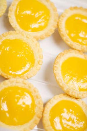 lemony: Bright Yellow Lemon Tarts On A Cooking Tray Stock Photo