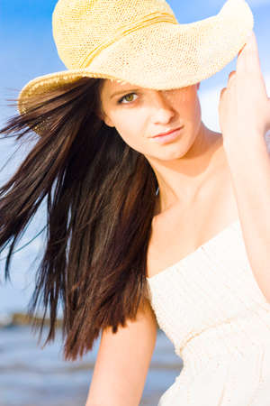 tresses: Beautiful Young Summer Beauty Woman Wearing Hat, Sea And Blue Sky Background