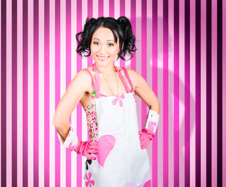 work gloves: Happy vintage maid with big smile wearing work gloves and apron. Retro cleaning service Stock Photo