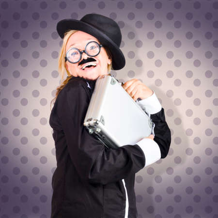 jaunty: Image of a funny female character in suit showing work as fun when hugging briefcase tightly. purple dot backdrop Stock Photo