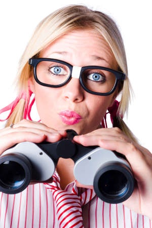 brainy: Conceptual image of a nerdy brainy businesswoman making a moue of surprise as she looks through binoculars to study future development Stock Photo