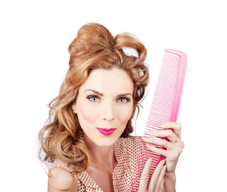 impish: Cute picture of a retro female hairdresser smiling with large salon hair comb. Old fashion hairstyling