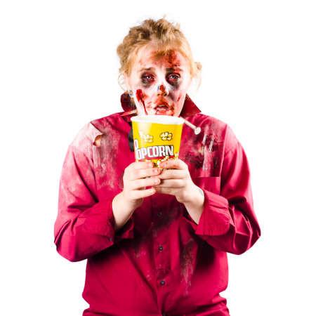 slasher: A zombie woman with a bucket of popcorn, scary movie concept
