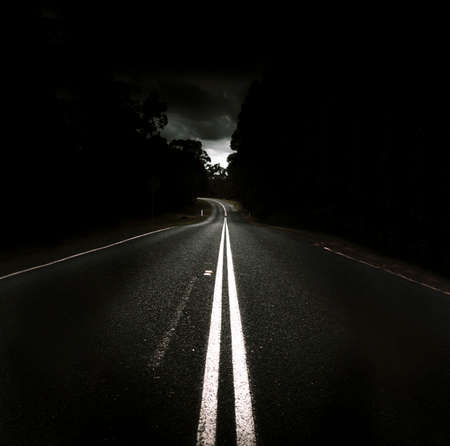 vast: Vast Stretch Of Straight Road Lie Ahead With A Bend At The End When On A Journey Of Distance Stock Photo