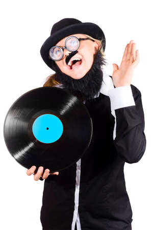 black rimmed: Woman in strange costume of bowler hat, black jacket, wide rimmed spectacles , fake mustache and beard  holding vinyl long play record isolated on white background