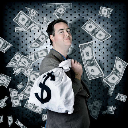 greedy: Business man stowing away cash inside bank vault when hording away finance money bag with greedy expression