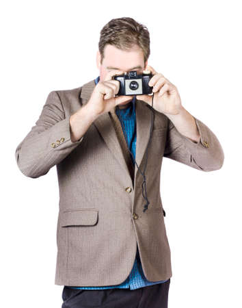 capturing: Portrait Of Businessman Capturing Photos With Vintage Camera On White Camera Stock Photo