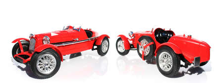 supercharged: Front And Rear Perspective Views Of An Classic Red Replica Model Car