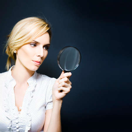 clues: Business woman with magnifying glass, concept of a crime scene detective searching for clues, scientific research, quest for answers or conducting an inspection