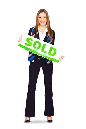 commercialism: Studio Full Body Isolated Portrait Of A Happy Smiling Woman Holding A Blank Sold Sign Banner Or Notice Is A Successful Sales Concept, On White Background