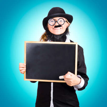 schoolmaster: Funny science school teacher smiling while holding a blank chalkboard in a scientific education copyspace concept Stock Photo
