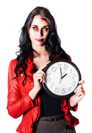 expectancy: Young glamorous woman in red jacket tired and with head and facial injuries holding a large clock isolated on white background