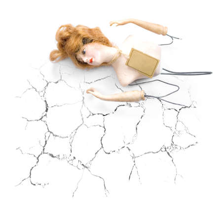 despairing: Inspired By Heartbreak A Broken Doll Lays Abondoned And Lost After A Cracked And Broken Romance Stock Photo