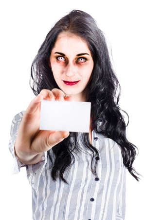 credentials: Scary female zombie handing over business card credentials isolated over white background Stock Photo
