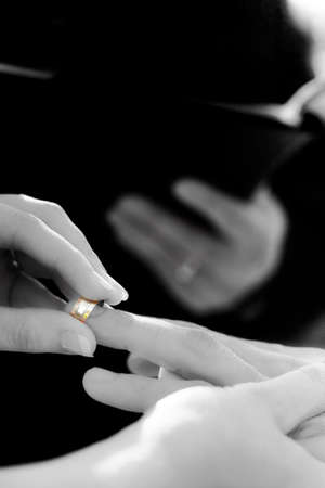 dignified: Black And White Image Of Rings Being Exchanged By A Bride And Groom During Wedding Matrimony