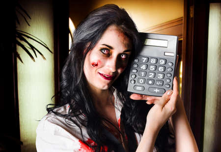 reanimated: Concept image of a female devil business woman in terrifying makeup holding a calculator to portraying negetive cash flow in businesses