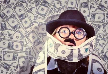 outgoings: Quirky vintage portrait of a funny business man covered in US Dollars. Drowning in debt concept Stock Photo