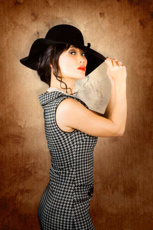 eloquent: Beautiful Chinese woman posing with fashionable summer hat on grunge wall Stock Photo