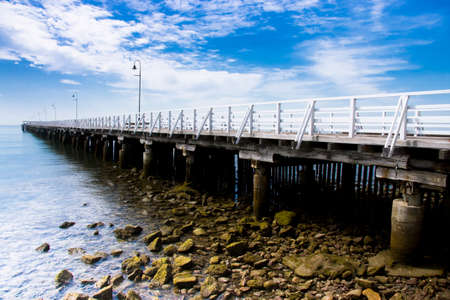 angled: Outdoor Architecture Landscape Of Shorncliffe Pier Angled Out Onto A Serene Horizon, Located in Queensland, Australia